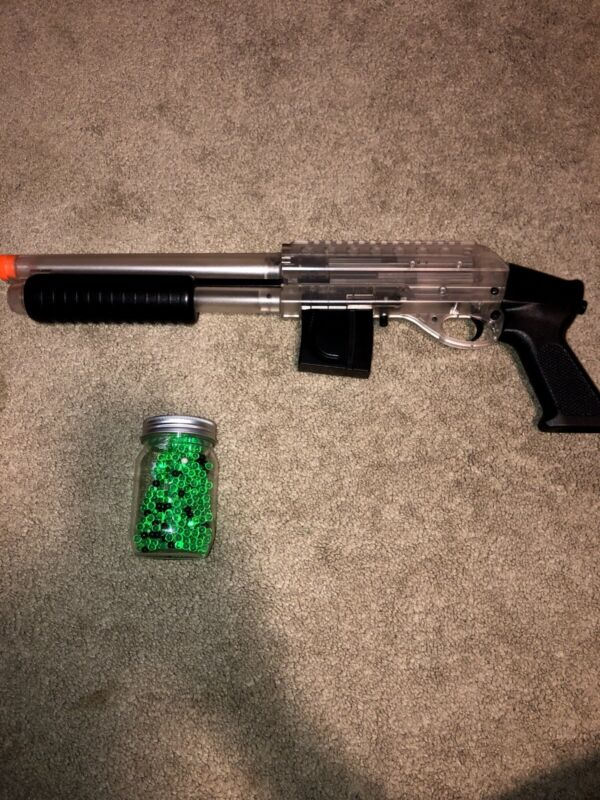 Pump Action Airsoft Shotgun With Small Canister Of BB's