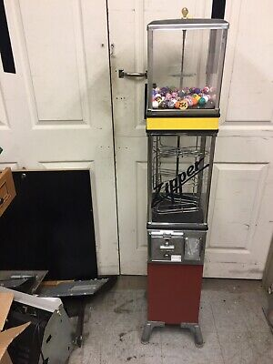 Zipper Gumball/bouncy ball spiral vending machine, Mfg. Victor