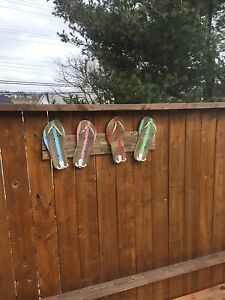 Pool fence towel racks
