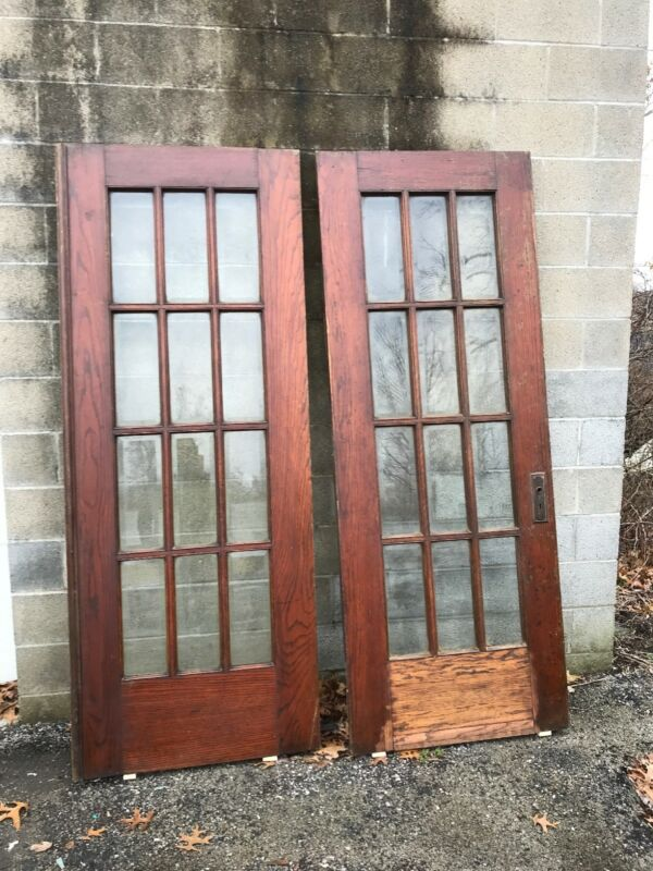 MAR 261 antique oak French doors beveled glass 64.25 x 84.25 By 1.75