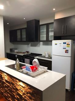 Modern 4 bedroom town house. Close to public transport, shops...