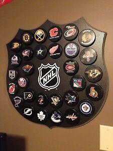 30 NHL Pucks and Display