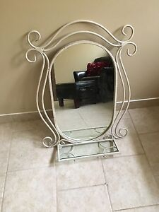 Iron mirror with glass sheld