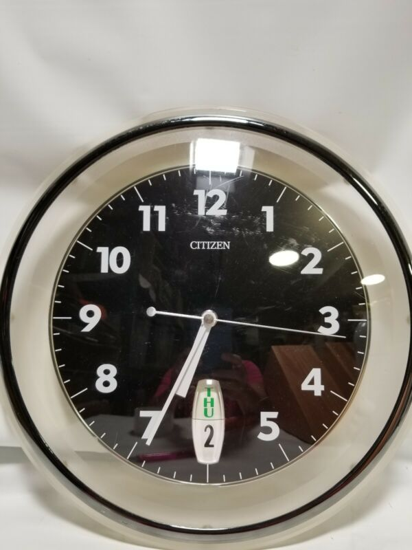 Citizen Wall Clock With The Day And Date On It