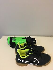 Soccer shoes and green shin pads
