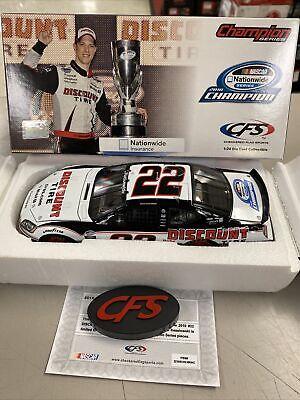 2010 Brad Keselowski #22 Discount Tire Champion Charger 1:24 NASCAR CFS USA FLAG