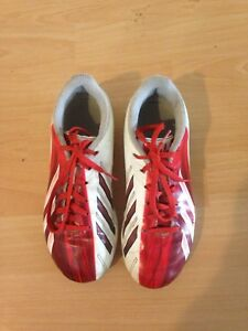 Red and white Messi size 1 soccer shoes