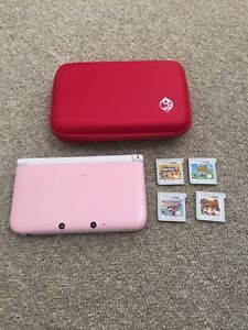 Pink Nintendo 3DS XL with case and 4 games