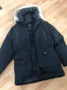 Winter downfilled coat with hood with wolf fur trim.