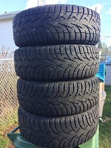 p215/60/16 inch Toyo Winter Tires on Rims / LOTS OF TREAD