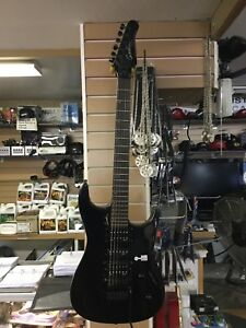 Assorted guitars and bass guitars
