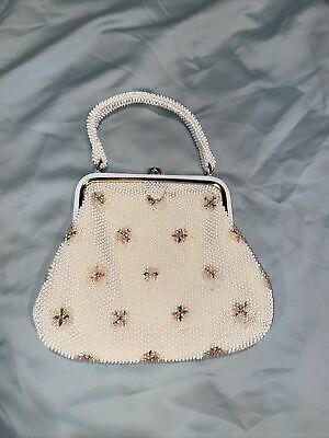 1950s Handbags, Purses, and Evening Bag Styles VINTAGE 1950'S CORDE BEAD HAND BAG BY LUMURED MADE IN USA CREAM Roses $29.99 AT vintagedancer.com