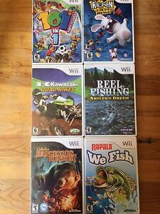 6 wii games and 2 controller mounts