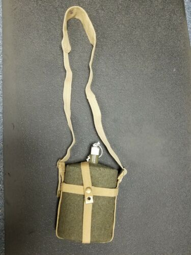 BRITISH WWII CANTEEN WITH CANVAS HOLDER AND STRAP. WWII DATED.