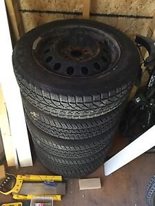 """5 14"""" 4 bolt rims with tire"""