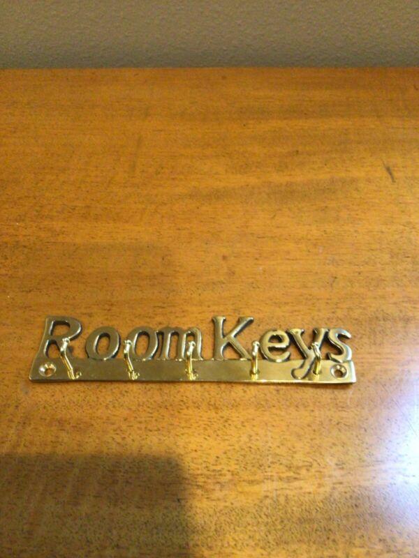 "Brass key rack. ""Room Keys"". 5 hooks"