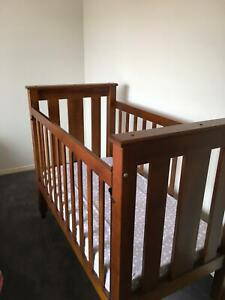 Solid timber cot and mattress