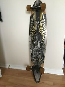 Sector 9 longboard with gullwing charger trucks