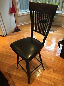 2 swivelling island height chairs - Joshua Creek Furniture