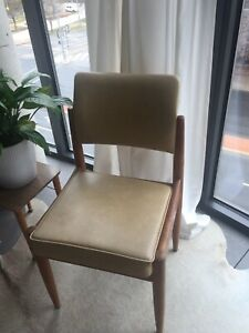 Mid-century modern dining chairs, beige vinyl and stained timber