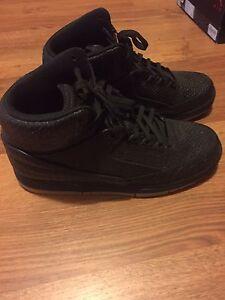 Size 9 black Nike pythons