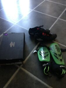 Youth size 3 soccer cleats and shin pads