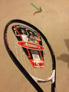 "BRAND NEW. Never used pair of  27"" tennis rackets with 3 balls."