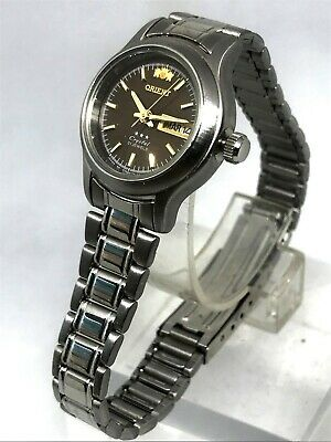 NEW ORIENT Crystal 3 Stars Watch 21 Jewels S,Steel Round Brown Face Day&Date WR