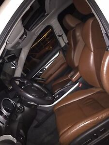 2010 Acura TL AWD fully loaded nav (creme in color)