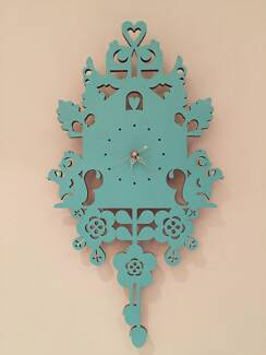 Wooden cut out cuckoo style analog clock with second hand