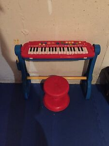 Fisher Price toy piano and drum