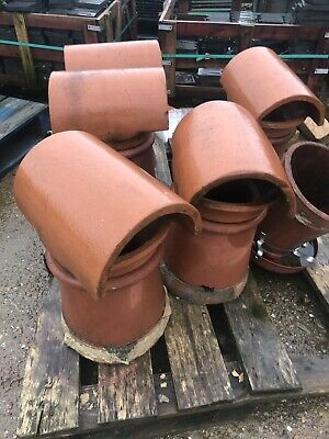 Reclaimed red  chimney pots.