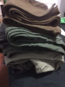 8 pairs of work pants Carhartt and Dickies