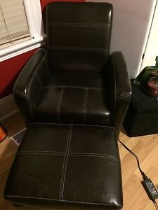 Black leather chair with foot stool