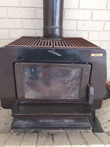 Fireplace slow combustion, needs refit of a collar, has iron grills Adamstown Newcastle Area Preview