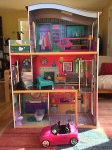 Barbie dollhouse with elevator and sports car