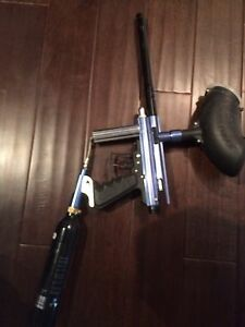 Semi automatic paintball gun with hopper and C02 cannister