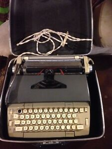 Antique electric typewriter in case