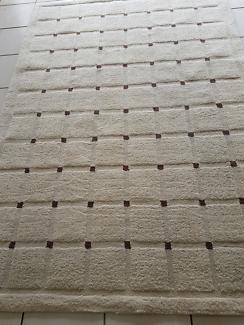 Beige squares woolen rug cleaned & sanitised