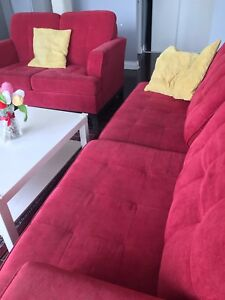 Red fabric sofa set with throw pillows