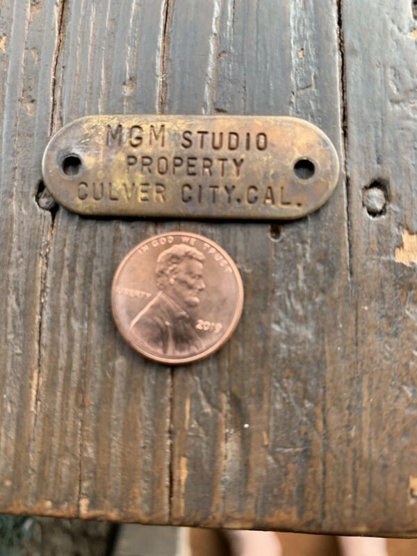 Brass MGM  Studio Property Tag