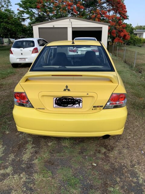 2003 mitsubishi lancer yellow for sale | cars, vans & utes | gumtree