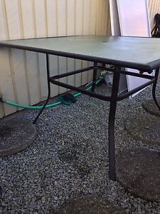 Outdoor glass and metal dining table