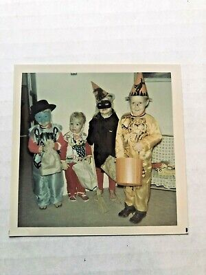 Vintage 1960s Halloween Costumes (Vintage 1960's Color Photograph of Four Kids in Halloween)