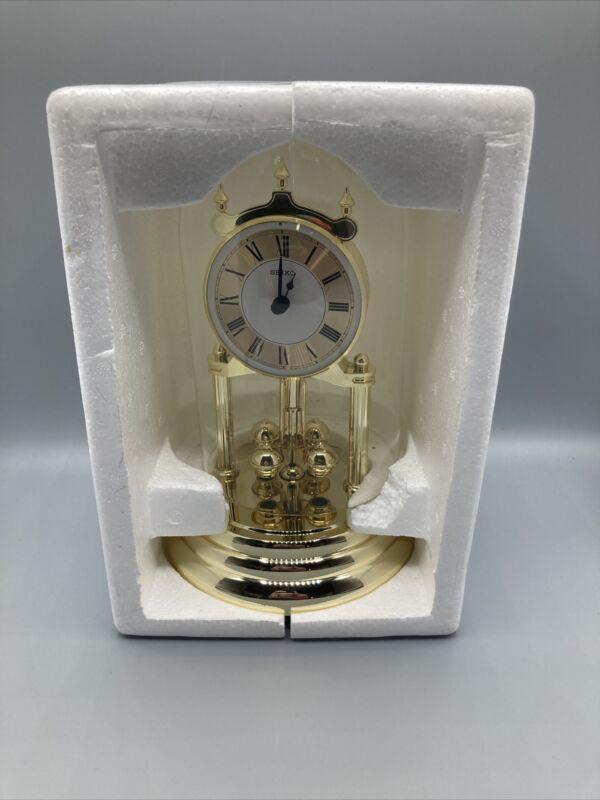 SEIKO ANNIVERSARY MANTEL CLOCK w/Revovling pendulum QHN006GLH New Open Box