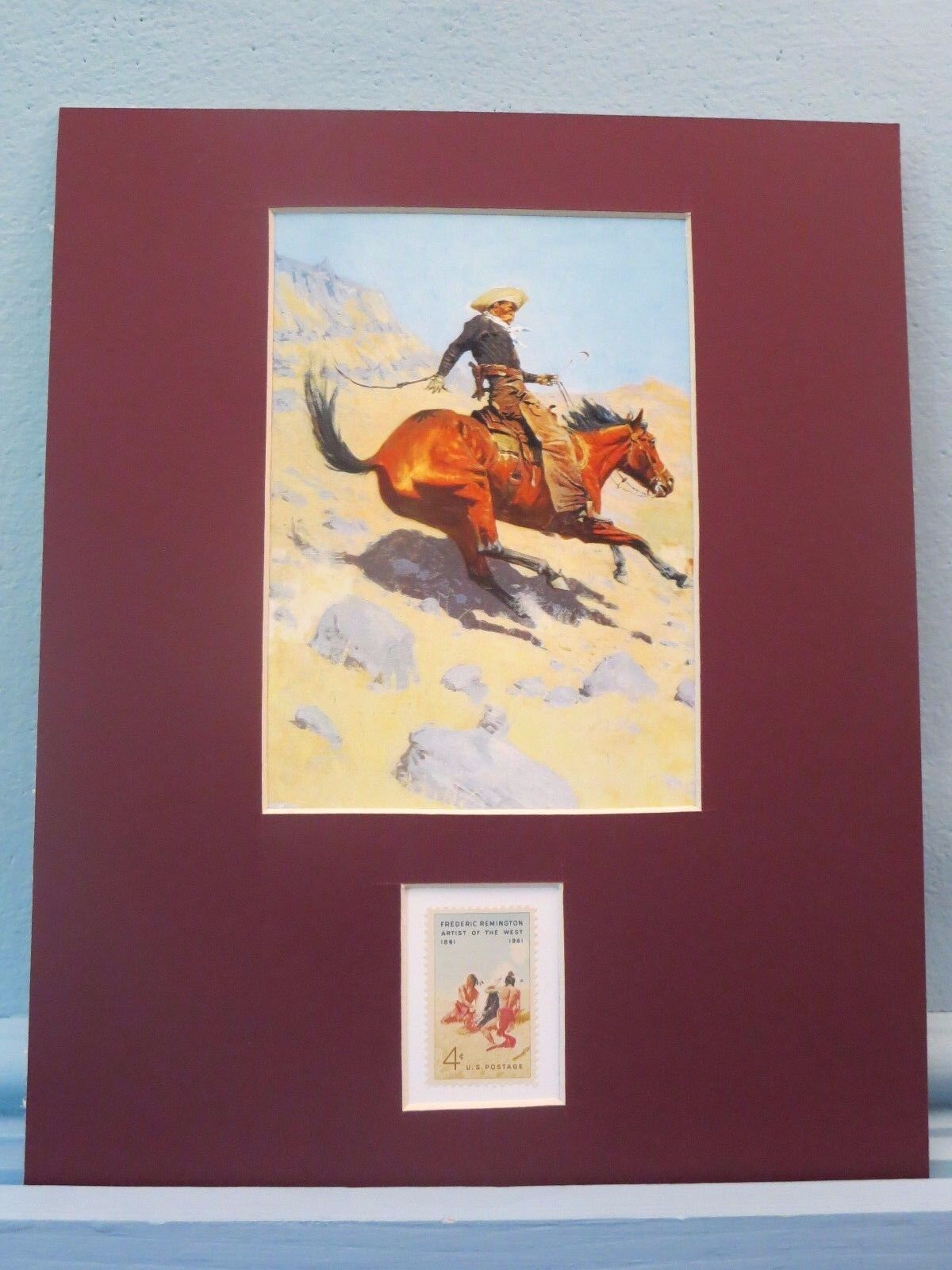 """""""The Cowboy"""" painted by Frederic Remington and his own stamp"""
