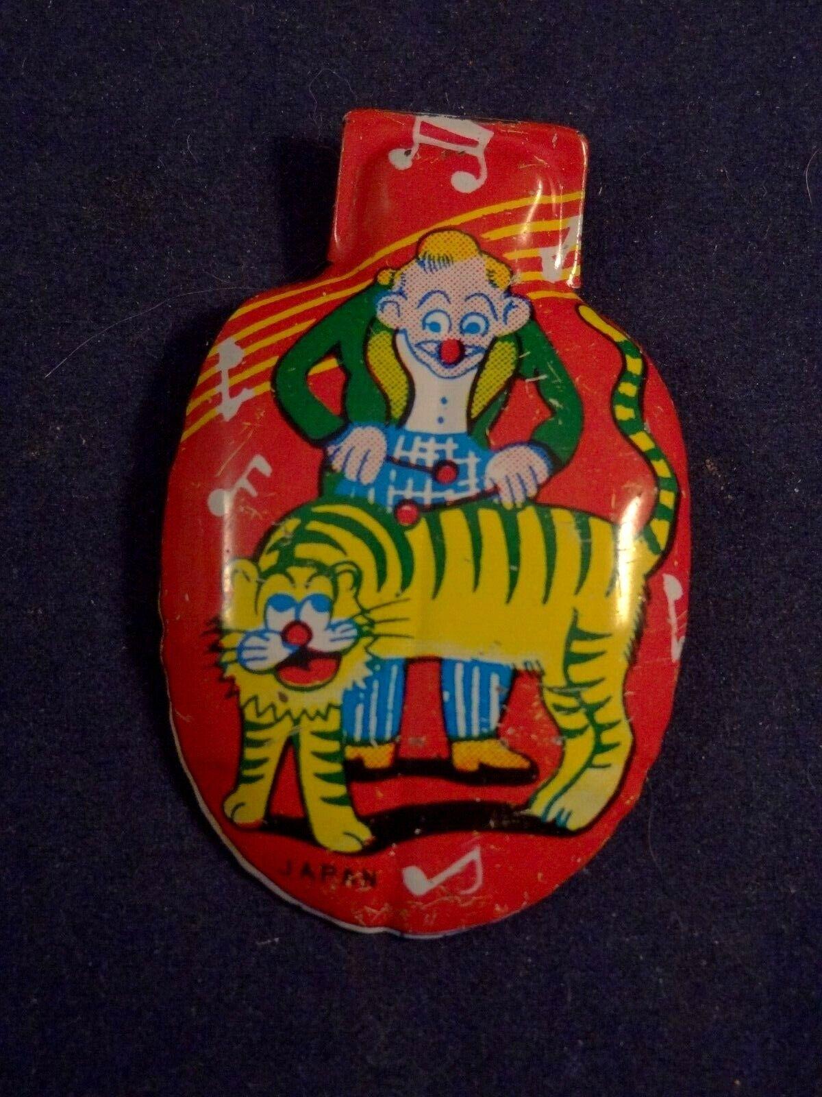 Ancien jouet musical tôle clic-clac cri-cri clown jouant du tigre années 60