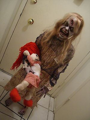 """ZOMBIE GIRL WITH DOLL 50"""" STANDING HALLOWEEN PROP."""