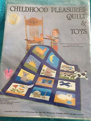 CHILDHOOD PLEASURES QUILT AND TOYS  48 INCH  X 64 INCH