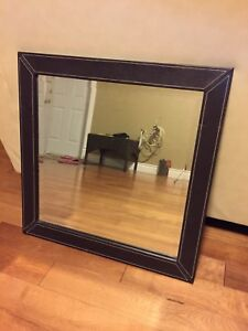Mirror with brown faux leather frame
